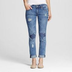 Refresh your jeans collection with the Women's Mid Rise Destructed Skinny Jeans in Medium Wash by Dollhouse (Juniors'). Play with peek-a-boo in the destructed jeans with printed pattern inset for layered look.