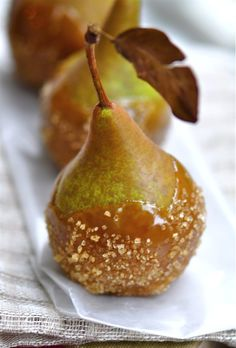 Salted caramel pears, so pretty for a Thanksgiving or Christmas table on a plate with caramel swirls!