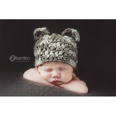 handspun bear beanie    These precious bear beanies are hand-crocheted using thick/thin handspun 100% merino wool. The hats have a beautiful texture & are VERY soft. These are perfect for new babies & photography props. I currently have the taupe/brown color, and a plum/purple color (see photo #3). I will have mo...