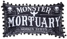 SOURPUSS WORKING STIFFS PILLOW - The rules of mortality do not apply at the Monster Mortuary. Our black and white, rectangular, pom pom pillow boasts that defying death is just another day's work for these stiffs.