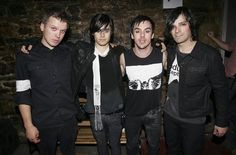 """NEW YORK - JULY 06:  Matt Wachter, actor Jared Leto, Shannon Leto, and Tomo Milicivitch of the group """"30 Seconds To Mars""""  pose for a photo backstage during a taping of MTV2's """"All That Rocks"""" at CBGB's on July 6, 2006 in New York City.  (Photo by Scott Gries/Getty Images) *** Local Caption *** Matt Wachter;Jared Leto;Shannon Leto;Tomo Milicivitch"""