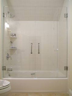 Frameless Glass Tub Enclosure. Framless glass doors on your bath tub can be designed and installed as an alternative to conventional sliding doors with tracks. You are looking at 2 tempered glass doors that open up completely-- clearing the toilet bowl with maximum access to the bath tub, making cleaning incredibly easy... and simplifying your life!