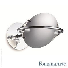 2 bowl-shaped glass discs of FontanaArte Nobi Wall Lamp are held in position by a system of tiny springs and fastened to the metal frame by 2 pins. #FontanaArte #walllamp #MetisLighting  Available at allmodernoutlet.com  http://www.allmodernoutlet.com/fontanaarte-nobi-wall-lamp/