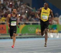 7e904a2e2fa Andre De Grasse (left) and Usain Bolt share a laugh at the finish line in  the…