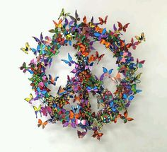 HOW MUCH DO I LOVE THIS BUTTERFLY PEACE SIGN WREATH?