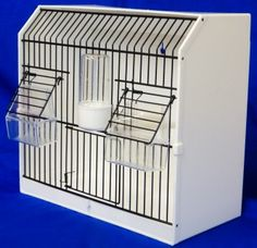 Plastic Display/Carry/Training Cage Twin FeederComes complete with two external feeders, one drinker and two perches30cm long 15cm wide 28cm highRemovable bottom tray from easy cleaningCan be wall mounte