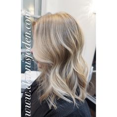 Natural color and platinum Balayage styled with beach waves. Hair by Danni in Denver CO