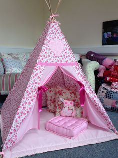A perfect hideaway for tiny people with big, colourful imaginations. With its cloth canopy and pretty colours, this pink fairy rose patterned teepee is a really cosy place to read, draw and play. It's particularly perfect for sleepovers, tea parties and lots of fun and games.  All of our teepees are handmade with lots of love by our sewing fairies, and each one takes a few hours to be created from scratch. Our fairies also make a range of cute, cosy cushions which are perfect for decorating…