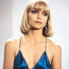 "Michelle Pfeiffer in ""Scarface"" - Scarface came out in 1983, but its influence is still felt to this day—the silky slip dresses and blunt bangs worn by Pfeiffer's character Elvira Hancock's are timeless. In 2012, Rihanna wore an Armani gown to the Grammys she claimed was inspired by Michelle Pfeiffer's costuming in the film. The same year, Jonathan Saunders cited Scarface as the inspiration behind his SS collection."