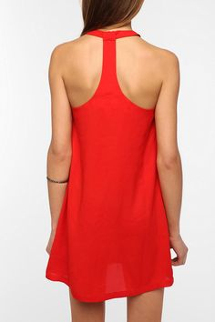 It's all about the back detailing this summer! Bright colored dresses with a cute back, can't go wrong.