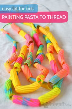 Painting pasta to thread - this was so much fun and the cool fluro pasta made great necklaces!