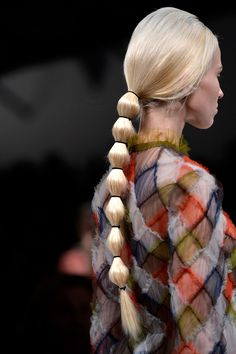 Valentino- For super-long strands, a segmented pony can prevent twists and tangles, and keep you neck cool.    - HarpersBAZAAR.com