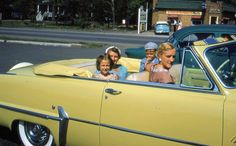 1950s with Grandma in the backseat. :-)