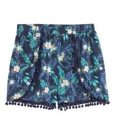 Shorts in an airy weave with a print pattern, elasticated waist, wraparound sides and decorative pompom trims.