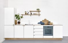 Oak on the inside. Solid laminate on the outside. A gorgeous kitchen to be experienced at Teglholmen, Copenhagen.