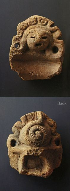 The part of the handle of an earthenware vessel having a shape of the face.   The back of this is a snake. B.C.3500-B.C.2500. Hachiouji Tokyo Japan. Jomon period.