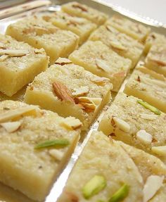Coconut Burfi   - 1 cup each: sugar, milk, whipping cream, unsweetened grated coconut (I used frozen grated coconut that I thawed in the microwave) 1 teaspoon ground cardamom 2 tablespoons sliced pistachios or almonds