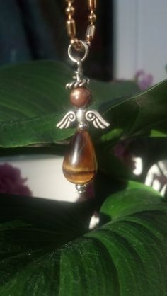 Check out this item in my Etsy shop https://www.etsy.com/listing/221000696/tiger-eye-crystal-angel-necklace-or