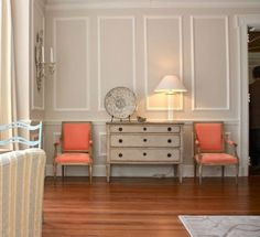 orange chairs & paneled walls