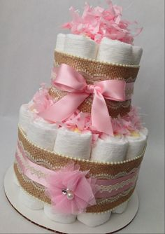 This 2 tier diaper cake is the perfect addition to your baby shower. A few can be placed on a table or around the space to decorate and accent your event! The possibilities are endless!! ------------------------------------------------------------------------- >>>SWEET INGREDIENTS<<< Each diaper cake is made with 27 Pamper Swaddlers Size 1 and lots of love! Each diaper cake is approximately 10 tall and 8 wide. Diaper cakes are available in multiple sizes, give me a shout if ...
