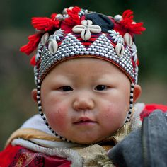 Vietnam | Eric Lafforgue Photography - Red Dzao Baby With A Traditional Hat, Sapa, Vietnam