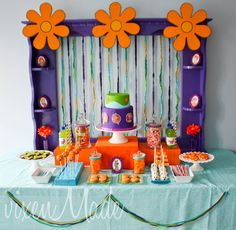 """Scooby Doo Party! Love some of the decoration ideas (except less flowers since my party would be for a boy). Also love the """"solve the mystery"""" idea and the Scooby snack cookies!"""