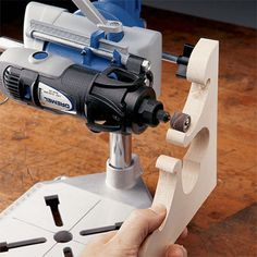 Tilt the tool holder at a 45-degree angle to allow for easy sanding of detailed items, such as pine shelf brackets.