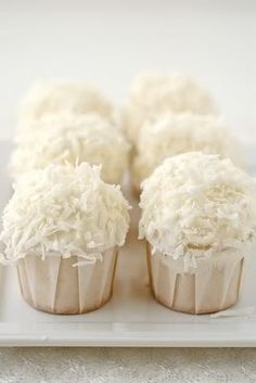 Coconut Cup Cakes- these look just like the ones we had at our wedding...to die for