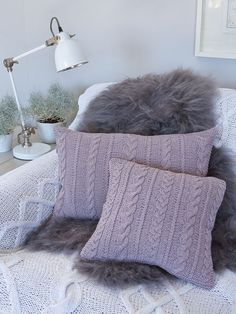 Deliciously soft and with a real home-knitted charm, these scrumptious cushions will add welcome warmth to your home.