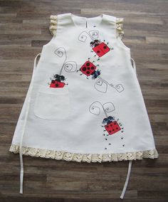 Items similar to Gray linen dress - painted dress - unit work - size by height cm for years - children summer clothing on Etsy Newborn Girl Dresses, Dress Painting, Baby Dress Patterns, Kids Frocks, Painted Clothes, Little Girl Dresses, Lady Bug, Baby Sewing, Diy Clothes