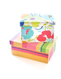 DIY fabric-covered box tutorial - uses wooden boxes from Michael's (sturdier than cardboard boxes!) and about 1/2 yard of fabric