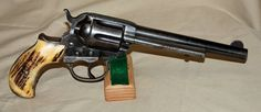 "Colt 1877 Lightning, .38 cal., 6"" barrel, stag grips, SN 163354, made in 1907. - The Colt M1877 was a double action revolver manufactured by Colt's Patent Fire Arms from January 1877 to 1909 for a total of 166,849 revolvers. The Model 1877 was offered in three calibers, which lent them three unofficial names: .32 Colt ('Rainmaker'); .38 Long Colt ('Lightning'); .41 Long Colt ('Thunderer'). (Wikipedia)"