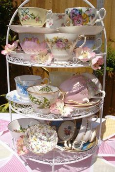 TEACUPS STACKED FOR TEA PARTY.
