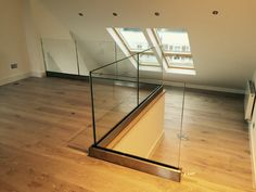 Internal frameless glass balustrade with base fixed U-channel, toughened laminated glass, no top rail.
