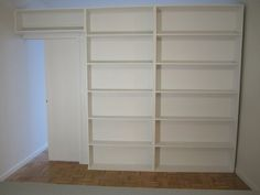 free-standing bookcase divider with hide away pocket door                                                                                                                                                                                 More