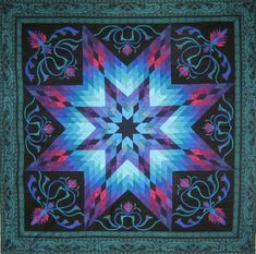 "Lotus. Jinny Beyer 2014 Quest quilt, made from jewel-toned 2 ½"" strips. I love the glowing effect of the graduated blue hues."