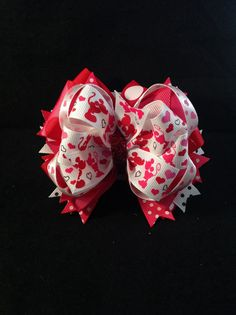 Check out this item in my Etsy shop https://www.etsy.com/listing/217875669/mickey-and-minnie-valentines-stacked-bow
