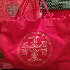 SALETory Burch Pink Tote! This is a beautiful big bag, as you can see it has been carried alot & loved very much! Her handles need a bit of care & repair! The body of the bag is still in amazing shape no stains or tears! Just her poor handles. Won't you adopt her? She still has a lot of fun times left in her! Price reflects the handles. Tory Burch Bags Totes