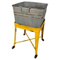 Finished in weathered yellow with bottom casters, this versatile washtub cart stows folded linens in your laundry room or keeps drinks cool in the kitchen
