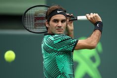 Roger Federer Photos Photos - Roger Federer of Switzerland in action against Frances Tiafoe of USA at Crandon Park Tennis Center on March 25, 2017 in Key Biscayne, Florida. - 2017 Miami Open - Day 6