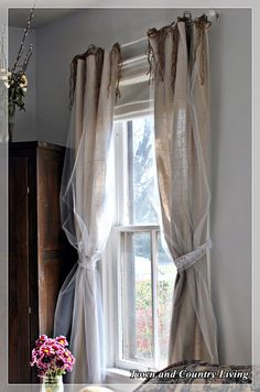drop cloth curtains with a touch of tulle - via Town and Country Living