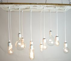 This pendant made of reclaimed wood and exposed bulbs is stunning