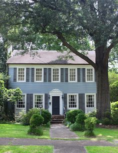 Light blue siding repainted shutters to black would like - House with blue door ...