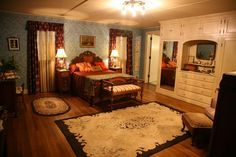 1930' s era bedroom, Victorian mixed with Art Deco, gorgeous closet built-in, drawers, upper cabinets and mirrored doors. Multi function and beautiful. Colors and overlays of the Victorian Era, much as one would assume real homes had in a 1930's home.