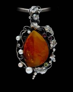 From the USA, a unique Baltic honey/cognac amber pendant handcrafted with sterling silver vine design and Peridot and Garnets. AlenaZenaJewelry on Etsy. Amber Jewelry, Gems Jewelry, Jewellery, Amber Gemstone, Gemstone Rings, Pearl Pendant, Pendant Necklace, Silver Earrings, Stud Earrings