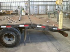 Turned regular30ft trailer into dovetail w heavy duty spring-loaded ramps