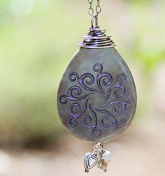Gentle swirl engraved stone pendant necklace by Terra Rustica Design. Available in my Etsy shop:  http://www.etsy.com/shop/terrarusticadesign #engraved #stone #pendant