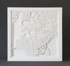 Show your Brooklyn pride with this modern laser cut map. Composed of 3 layers of monochromatic wood or acrylic, the intricate street grid takes
