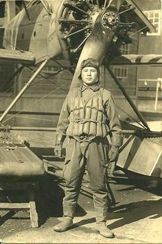 Japanese Navy pilot with a Yokosuka E14Y seaplane