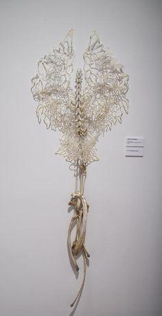 "Gianna Paniagua ""Flesh and Bone"" handcut, burned, and wax covered rice paper; bones; twine"